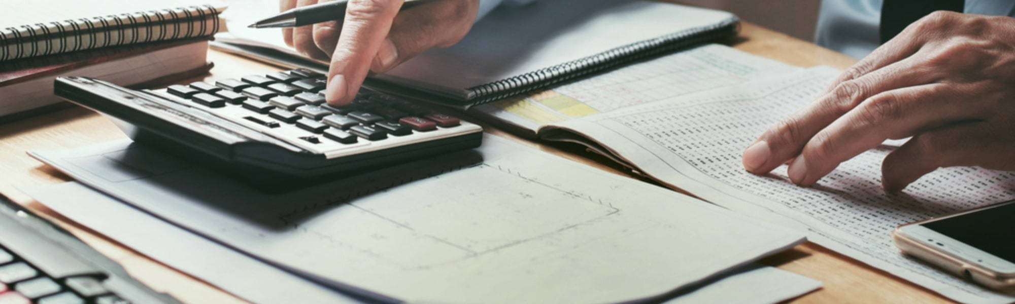 accountant using a calculator